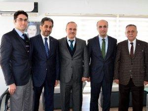 Atay,  İhlas Pazarlama ve Türkiye Gazetesi'ni ziyaret etti