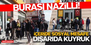 İÇERİDE SOSYAL MESAFE DIŞARIDA KUYRUK