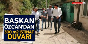 BAŞKAN ÖZCAN'DAN 300 METREKARELİK İSTİNAT DUVARI HİZMETİ