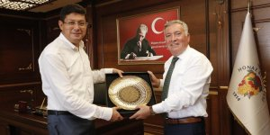 Başkan Özcan'dan anlamlı ziyaret